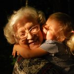 old lady and little girl hug
