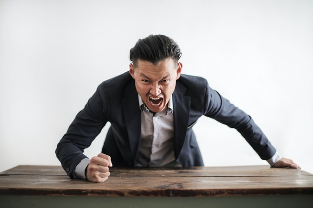 Angry boss screams at camera