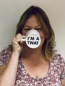 Alison with a mug that says 'I am a TWAT'
